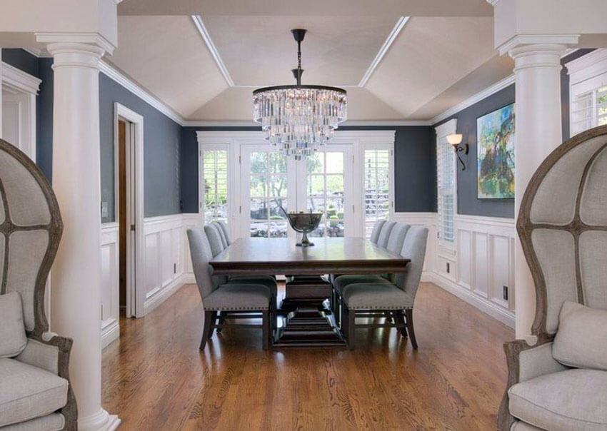 Gray and white dining room with glass chandelier