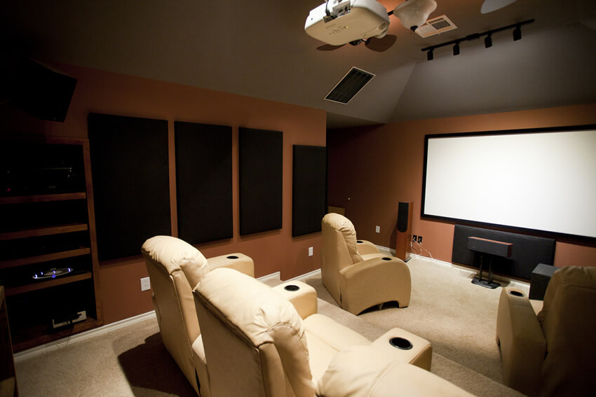 Home Theater With Cream Color Reclining Seats
