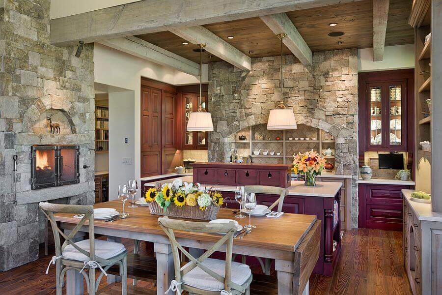 Lots of precious memories are created in the kitchen. This vintage kitchen with fireplace combines traditional aesthetic with the familiar feel of exposed bricks and worn wood with modern conveniences
