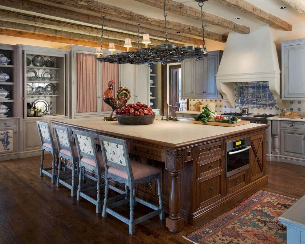 Farmhouse style structure kitchen with island stove brings to mind the generous portions of comfort meal enjoyed with family and loved ones. A large island with breakfast bar is well seated at the center of the kitchen