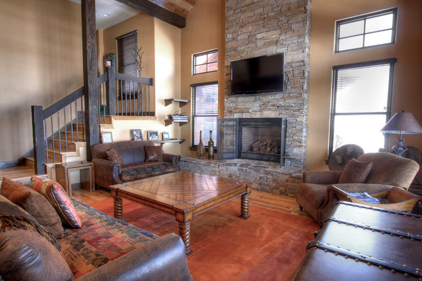 Leather Furniture In Living Room With Stone Fireplace