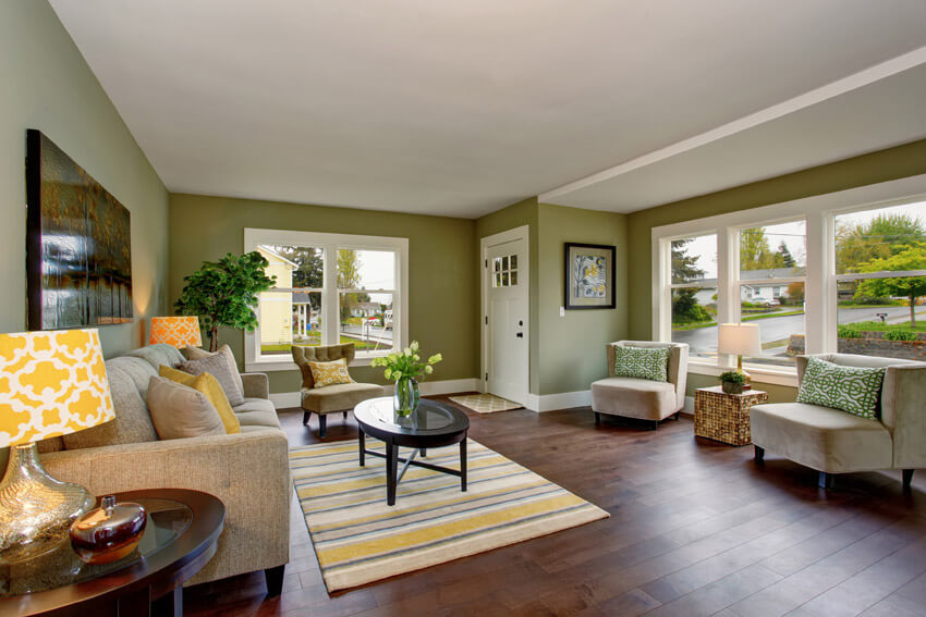 Living Room With Green Paint And Wood Flooring