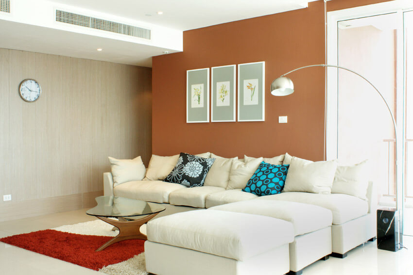Living Room With Tan And Orange Accent Walls