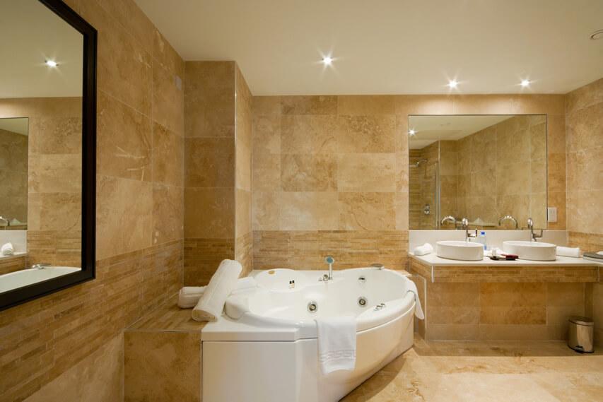 Luxury bathroom dual pedestal sinks jacuzzi tub