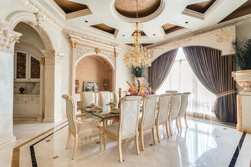 luxury formal dining room with chandelier and cupola ceiling