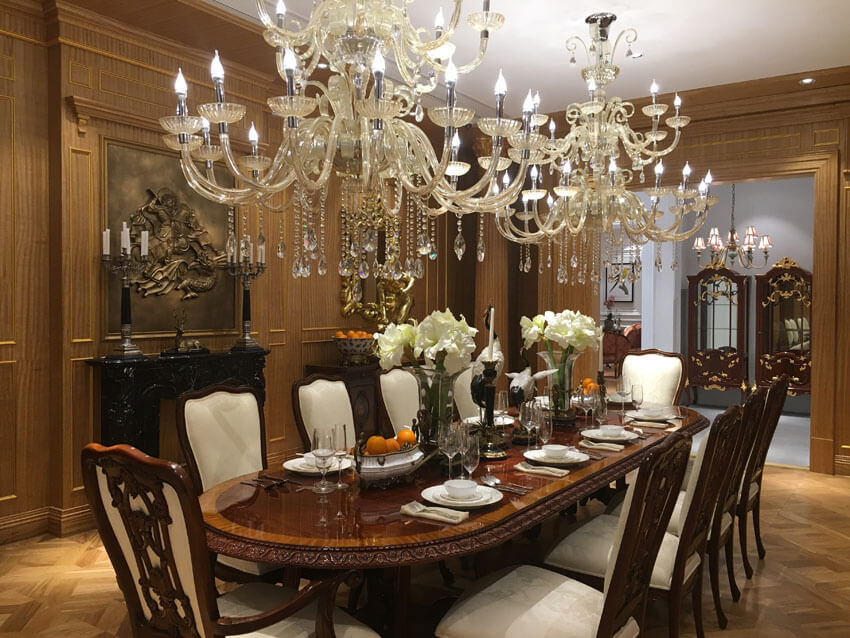luxury formal dining room with two chandeliers