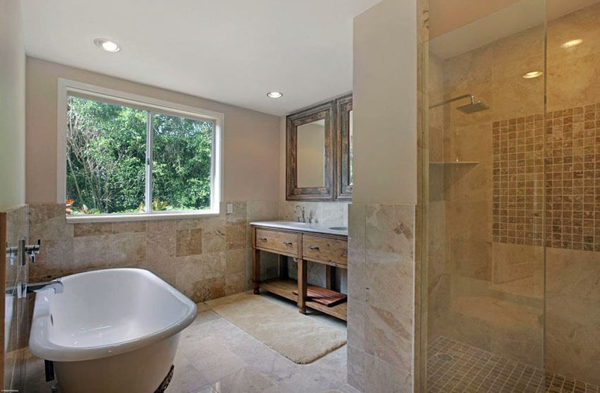 luxury master bathroom with rain shower and travertine tile with mosaic square insert