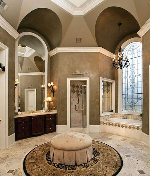 luxury master bathroom with travertine tile shower and high ceilings