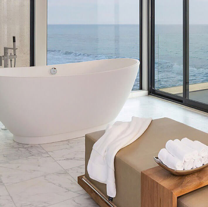 marble bathroom with ocean view