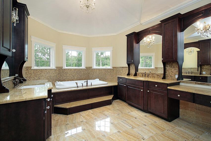 Master bath dark wood cabinetry chandelier