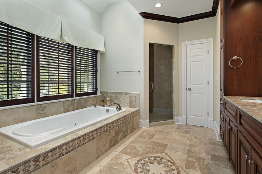 Master bath intricate tile floor design