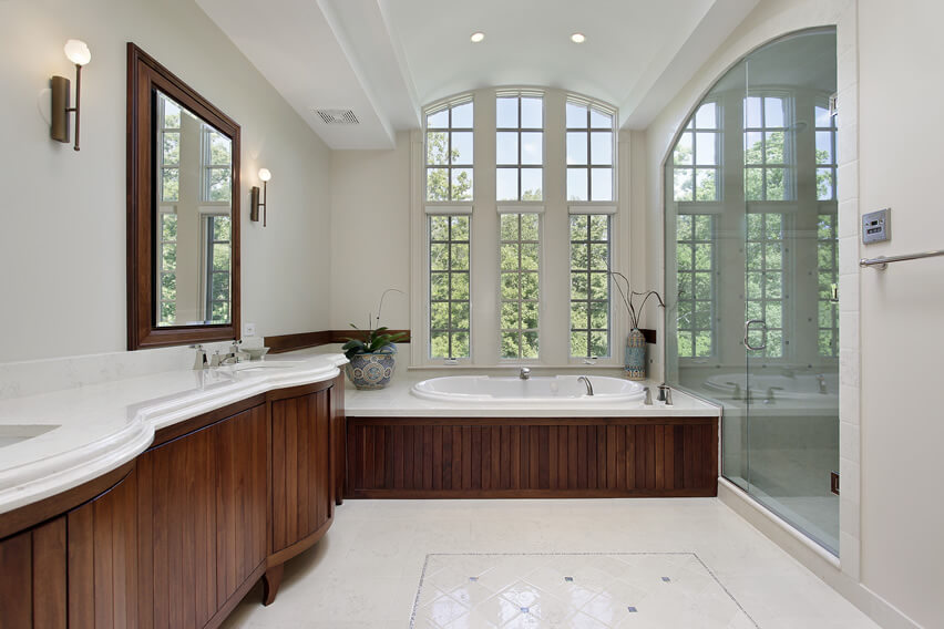 Master bath large glass shower door wood cabinetry