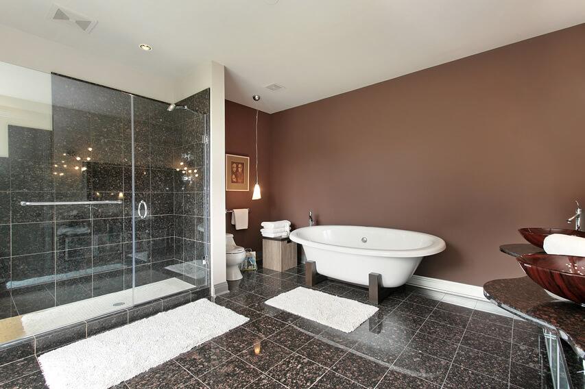 Master bath pedestal sinks black tile shower