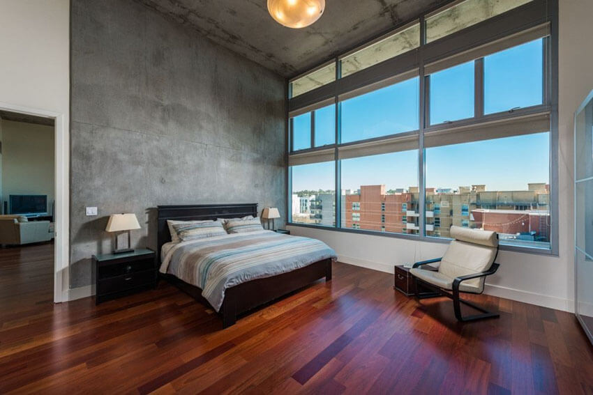When sweeping brazilian cherry wood floors are laid at the feet of your bed, and you have amazing concrete walls around you, you need nothing more to create a stunning enclave as seen in this modern bedroom with brazilian cherry wood floors and concrete walls