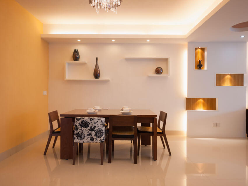 modern dining room with lighted wall alcoves