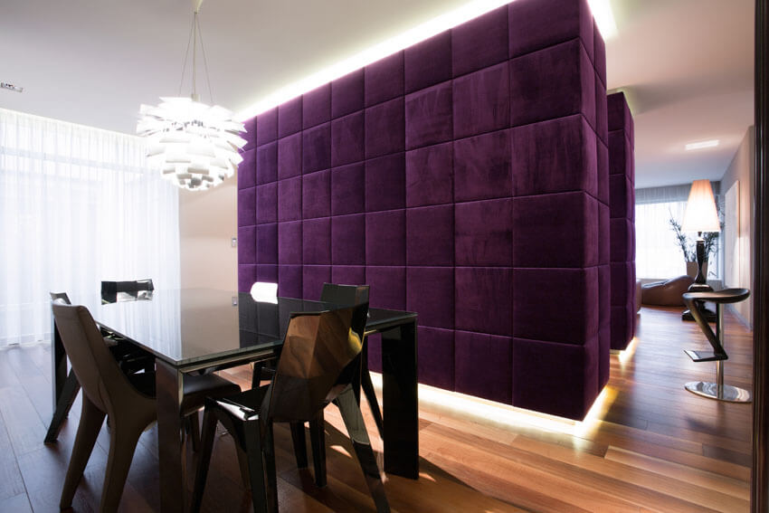 modern dining room with plush purple accent wall