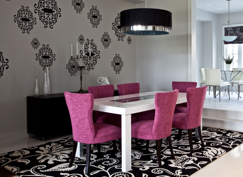 modern dining room with purple chairs large area rug