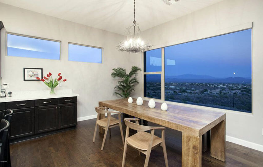modern dining room with solid wood table large picture window