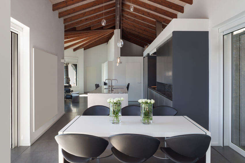 modern dining room with vaulted ceiling