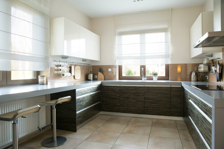 This is another modern kitchen design small space that is able to make the most of its space. It combines light cream colored walls with cream ceramic floor tiles and white ceiling. The cabinet doors in laminated zebrawood are accessorized with continuous drawer handles