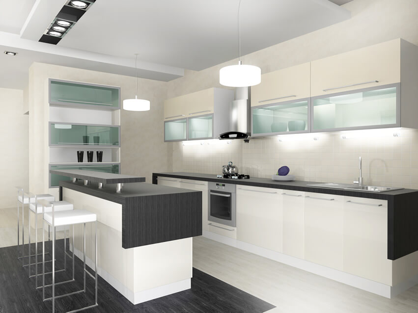 The focus of this modern small kitchen black white design is on its clean, traditional hues. The floor is covered with white porcelain tiles with black accent porcelain tiles underneath the bar counter. The walls and ceiling are also painted in white