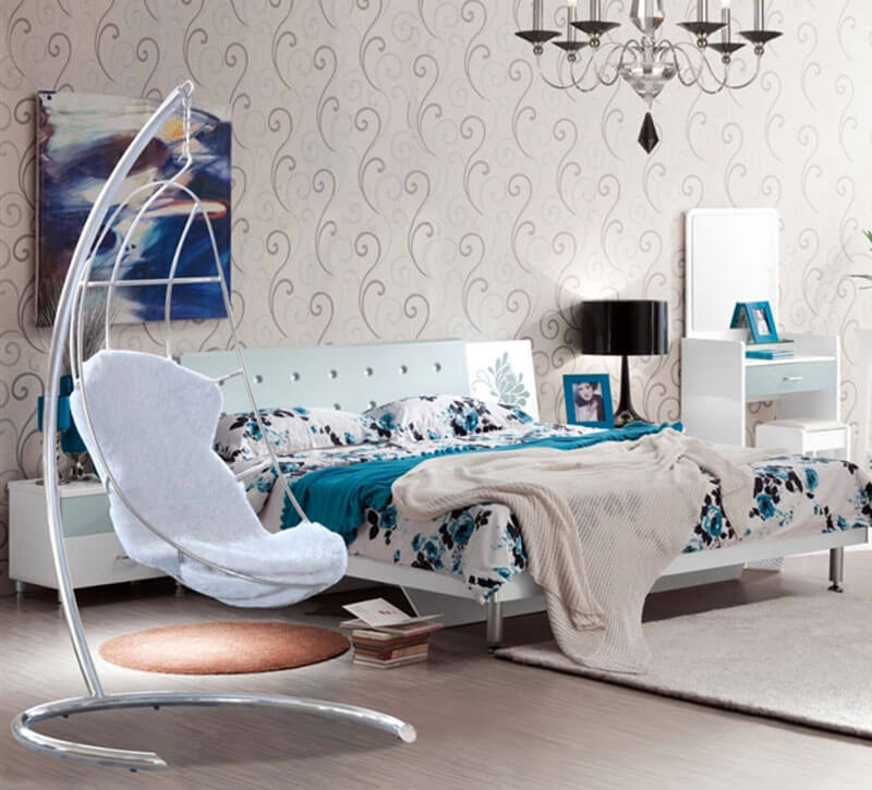 The moon shaped swinging chair in modern bedroom exceptionally accents the texture of the bedroom. The white wool fabric seat cushioning together with the stainless steel base make a good addition to the bedroom