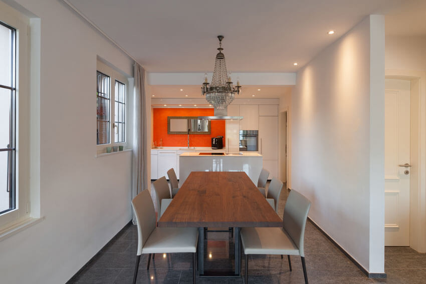 narrow modern dining room open to kitchen