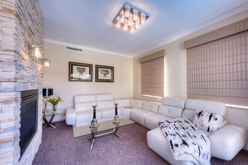 Purple Carpet In Living Room With White Furniture
