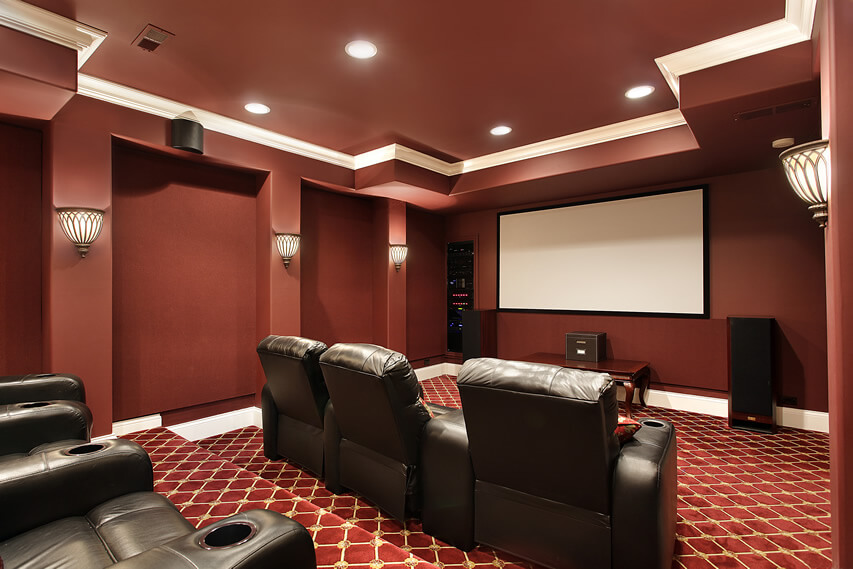 Red Home Theater With Brown Leather Chairs