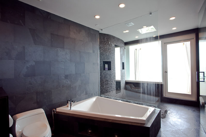 resort style bathroom with dark accent wall