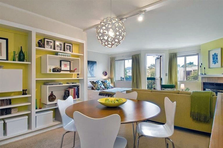 retro dining room with yellow decor and large globe light