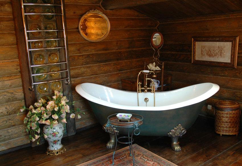 rustic bathroom in wood with claw foot bathtub