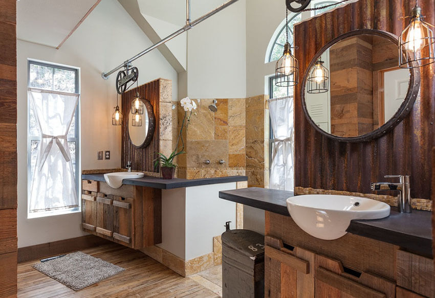 Instead of sconces, which are most common in traditional bathrooms, this rustic dual sink bathroom with wire cage pendant lights uses classic pendants to brighten up the space. The wire cage of the lights helps accent the rustic texture of the room