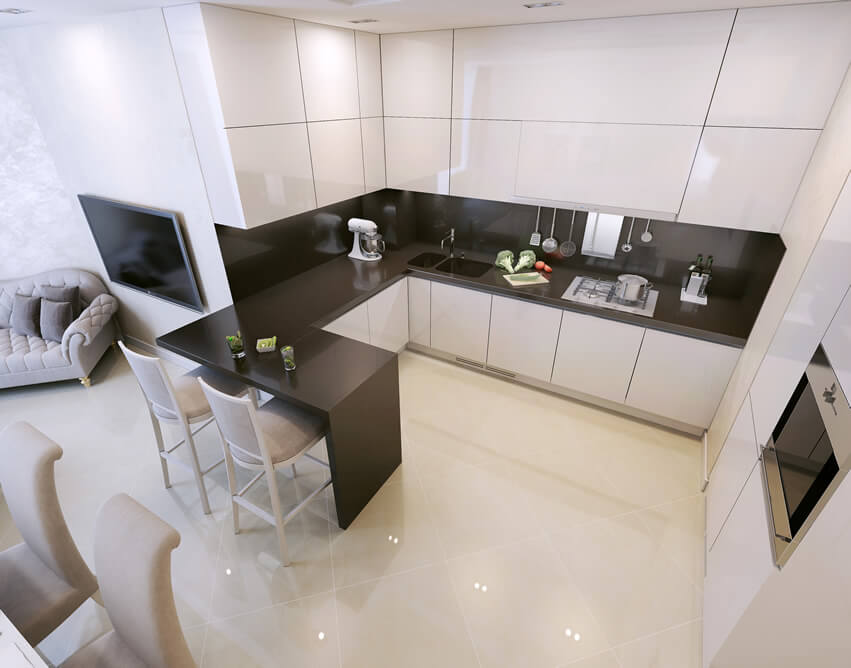The small modern kitchen black and white theme of this kitchen alongside its minimalist design approach helps keep the clutter at the minimum as the white porcelain tiles reflect light to brighten the entire space