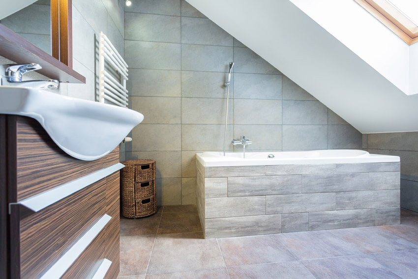 upgraded bathroom with slanted ceiling and skylight