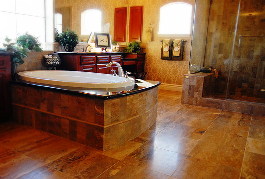 upscale designer bathroom with large tile