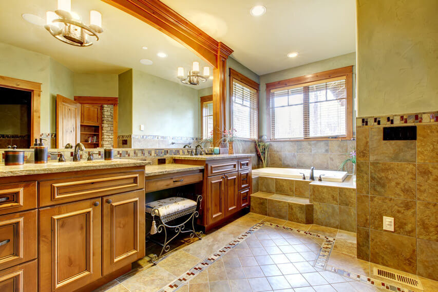 Upscale master bath green brown theme