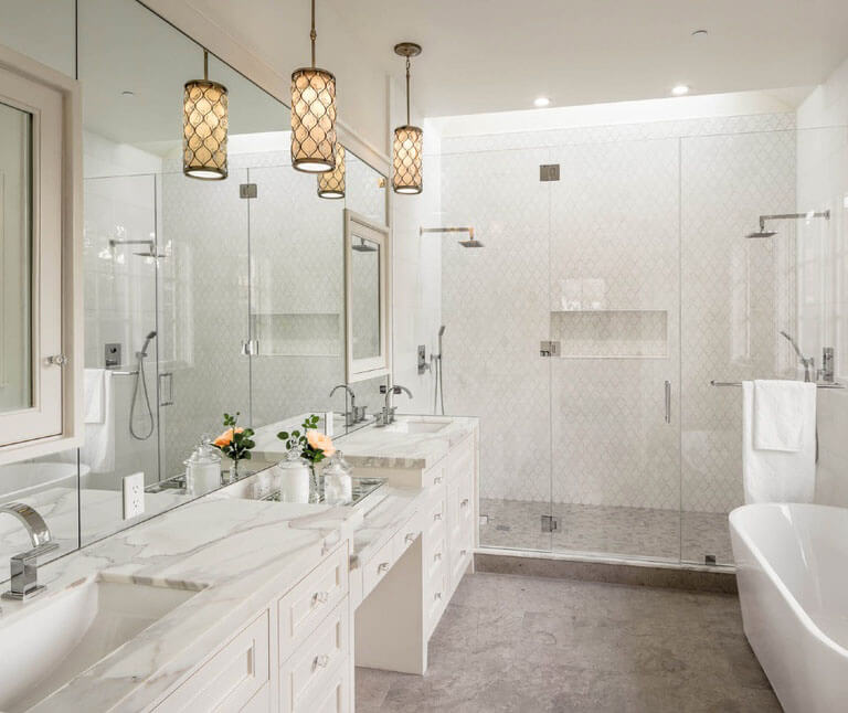 Whether they are hung over the sink or bathtub, pendant lights will surely, nicely brighten any bathroom every time. The hanging chrome gold pendants in this white bathroom with pendant lights do not only brighten the space, but also bring beautiful contrast