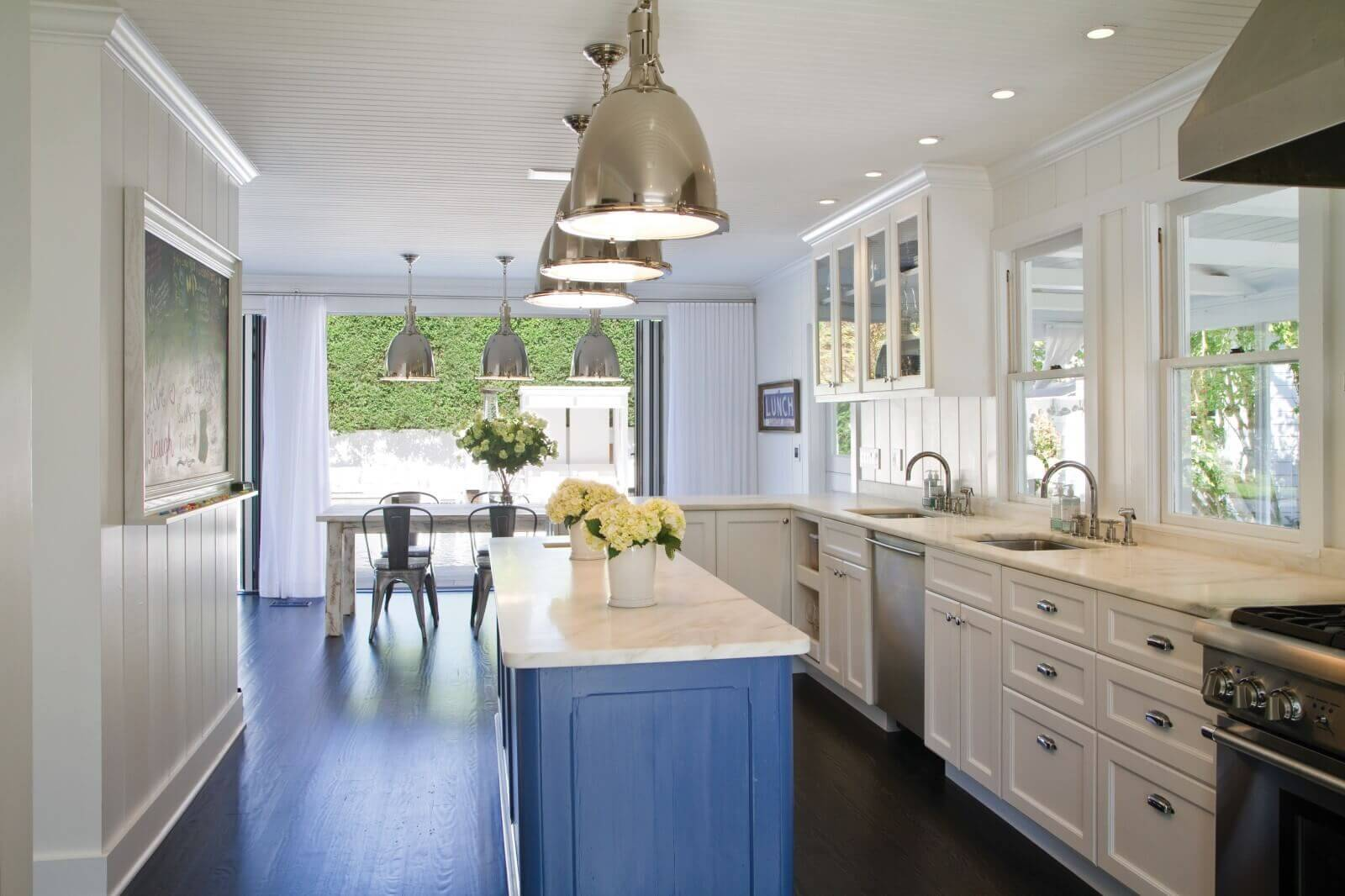 Beach styles are usually open concepts, and nothing can do it better than a great open room like the kitchen or dining area. Blue throughout this open kitchen creates a very nice white beach style kitchen design with island