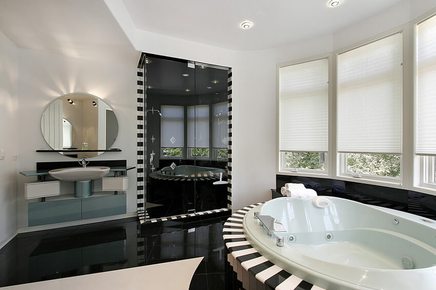 Space does not really have a place in this white black modern bathroom piano keys design, but the striking black granite flooring and white and black piano keys design around the sink and the shower give this room an excellent edge