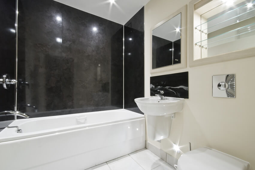 This rich bathroom design is an impressive home décor idea for small space. Combined with the black accent wall, the white black themed bathroom tiles bring a sense of openness and brightness to the space