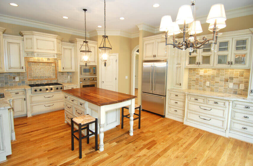 This white kitchen with honey and light wood floors is very gorgeous and elegant. The natural light wood flooring and classic white cabinetries keep the space very luxurious and traditional