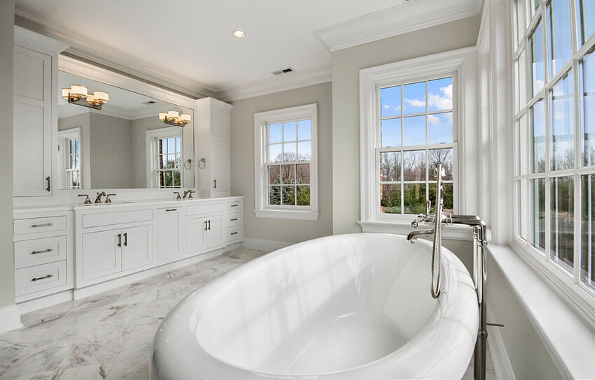 white marble bathroom with great lighting and windows