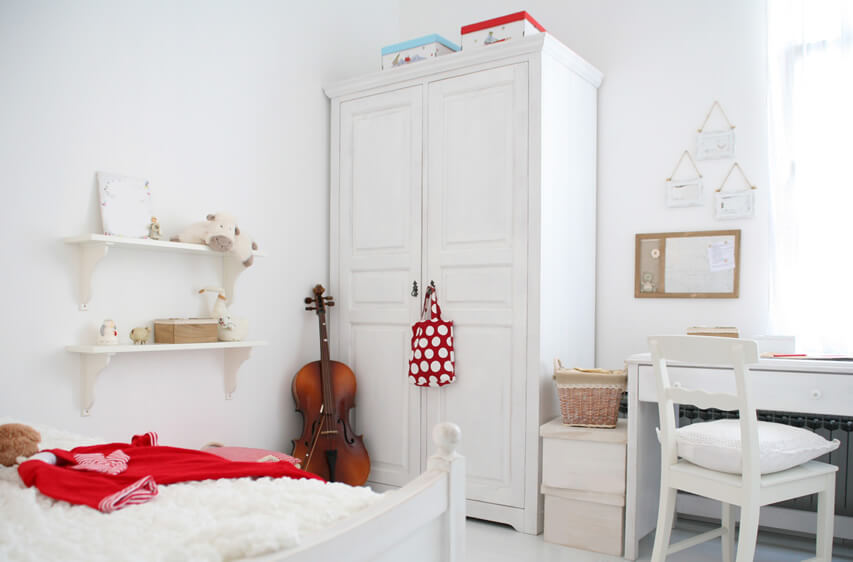 The white wardrobe in bedroom nicely blends with the color and texture of the room. It comes with a unique door design which has a slimline perimetral profile and an integrated smart handle in a black finish