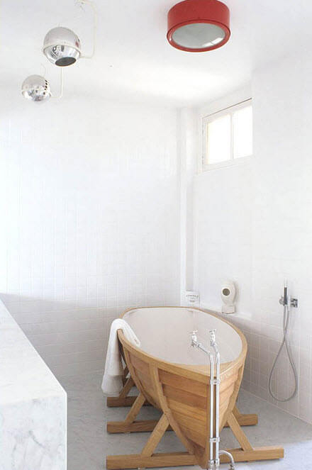 Original bathroom design with boat shaped tub