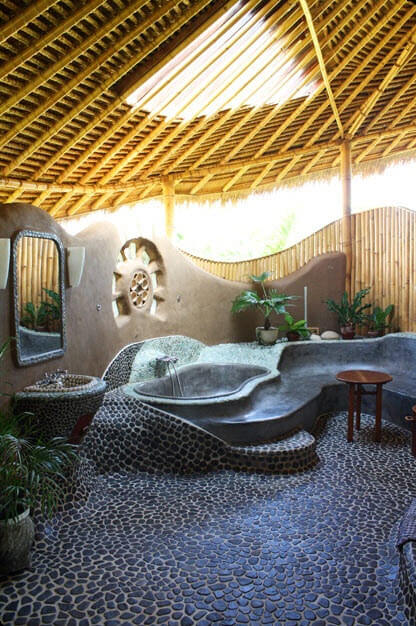 Original design of rustic bathroom with bamboo, stone and mud