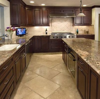 Beige kitchen with dark wood furniture