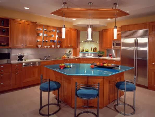 Kitchen with hexagonal island design with granite board