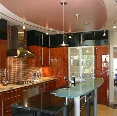 Modern small kitchen design with glass island