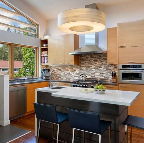Small kitchen with bar in white countertop